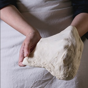 pizza dough is very elastic due to high gluten flour. To be avoided on a gluten free diet.